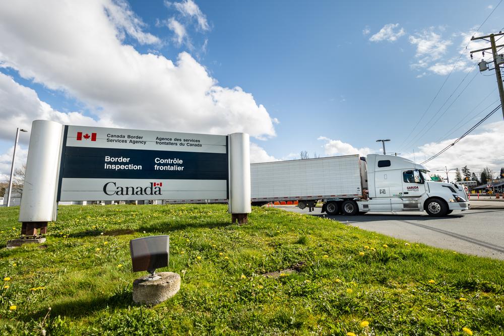 Surrey,,Canada,-,Mar,29,,2020:,Freight,Truck,Exiting,Canadian